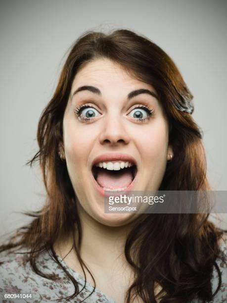 excited young woman with mouth open - mouth open stock pictures, royalty-free photos & images