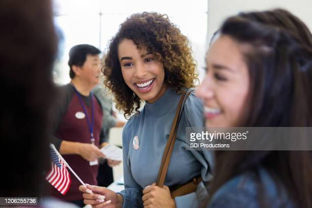 excited young women vote on election day - citizenship stock pictures, royalty-free photos & images