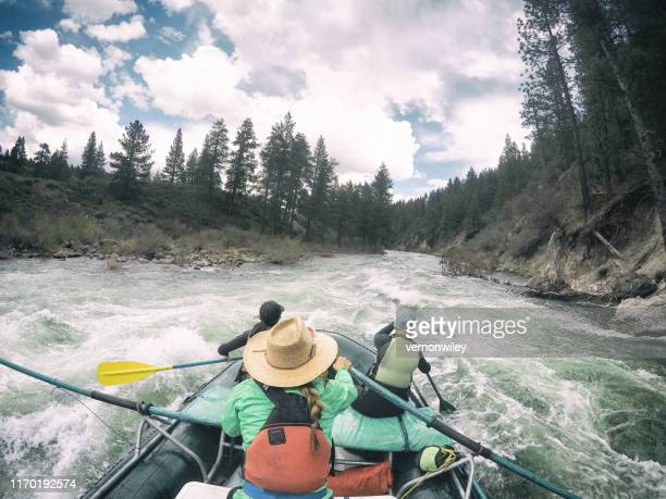 exciting day on the river with girlfriends. strong, women white water rafting on truckee river. - inflatable raft stock pictures, royalty-free photos & images