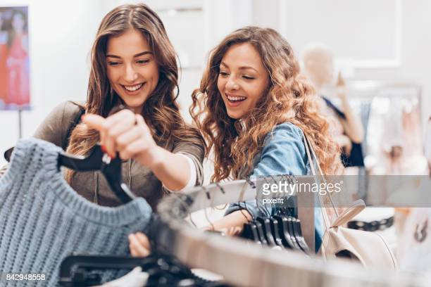exciting fashion finds - clothes rack stock pictures, royalty-free photos & images