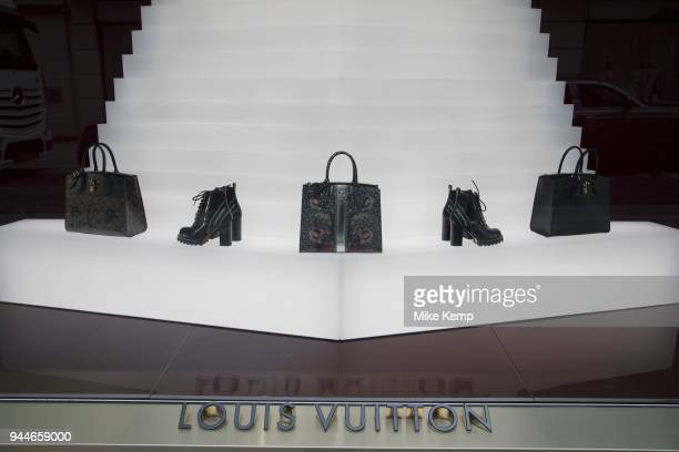 Exclusive clothes shop window for Louis Vuitton on New Bond Street in Mayfair London England United Kingdom Bond Street is one of the principal...