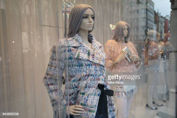 Exclusive clothes shop window of Chanel on New Bond Street in Mayfair, London, England, United Kingdom. Bond Street is one of the principal streets...