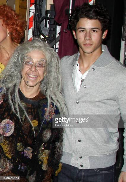 *Exclusive Coverage* Jackie Hoffman as Grandma and Nick Jonas pose backstage at The Addams Family On Broadway at the LuntFontanne Theatre on August...
