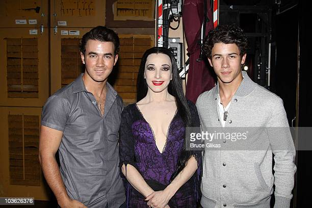 *Exclusive Coverage* Kevin Jonas Bebe Neuwirth as Morticia Addams and Nick Jonas pose backstage at The Addams Family On Broadway at the LuntFontanne...