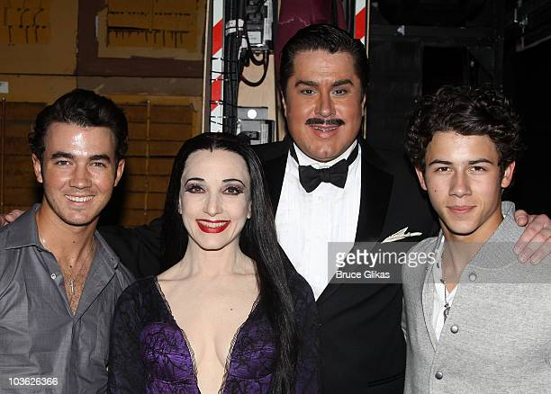 *Exclusive Coverage* Kevin Jonas Bebe Neuwirth as Morticia Addams Merwin Foard as Gomez Addams and Nick Jonas pose backstage at The Addams Family On...