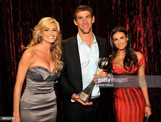 LOS ANGELES CA JULY 15 **Exclusive** ESPN Erin Andrews with swimmer Michael Phelps and actress Demi Moore pose backstage during the 17th annual ESPY...