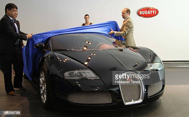 Exclusive Motors Managing Director Satya Bagla left with Bugatti Sales and marketing manager Europe Middle East and India Guy Caquelin sit in a...