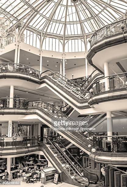 Exclusive shopping centre, Princes Square, Glasgow, with glass dome and open plan fllors with pillars and escalators.