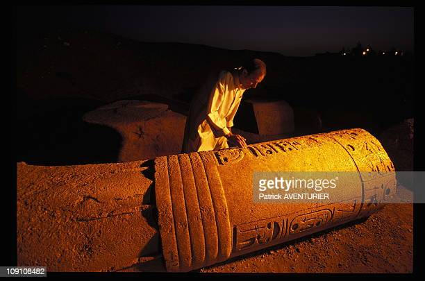 Exclusive The Forgotten Treasures Of Tanis On January 11Th 2002 Shaft Of A Column Ahmed Temple Guard Looks At An Inscription A Cartouche Containing...