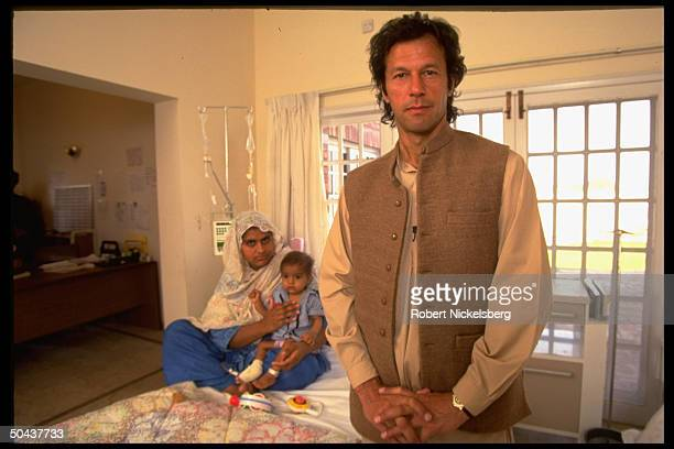 Excricket star Imran Khan in cancer hospital built in memory of his mother re his call for return to Muslim values end to natl violence
