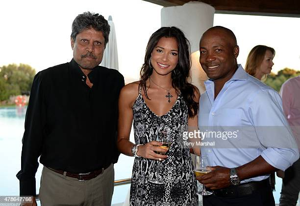 ExCricketers Kapil Dev and Brian Lara pose with Jamey Bowers at the Welcome Dinner presented by Autism Rocks prior to The Costa Smeralda Invitational...