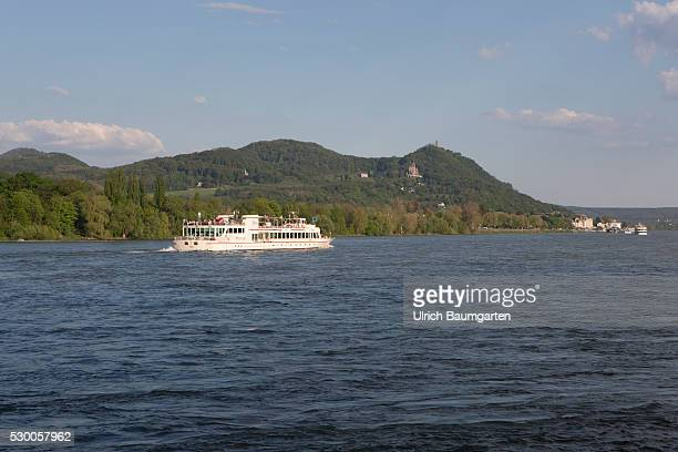 Excursion boat on the Rhine river In the background the Siebengebirge with the Drachenfels