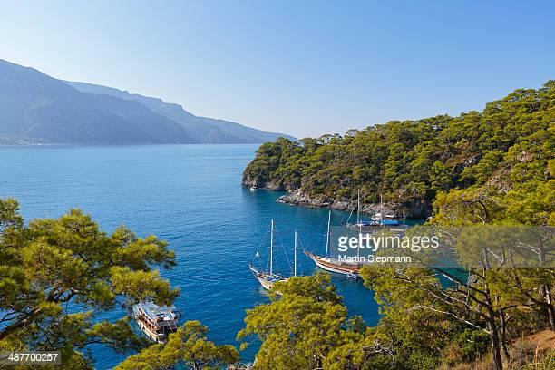 Excursion boats mooring off Oeluedeniz near Fethiye, Mugla Province, Lycian Coast, Lycia, Aegean, Turkey