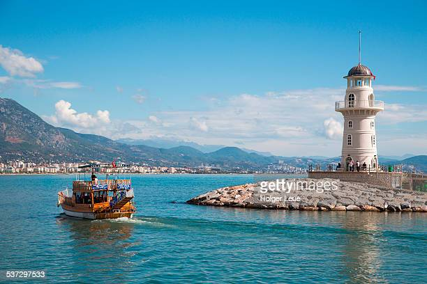 Excursion sailing boat and lighthouse