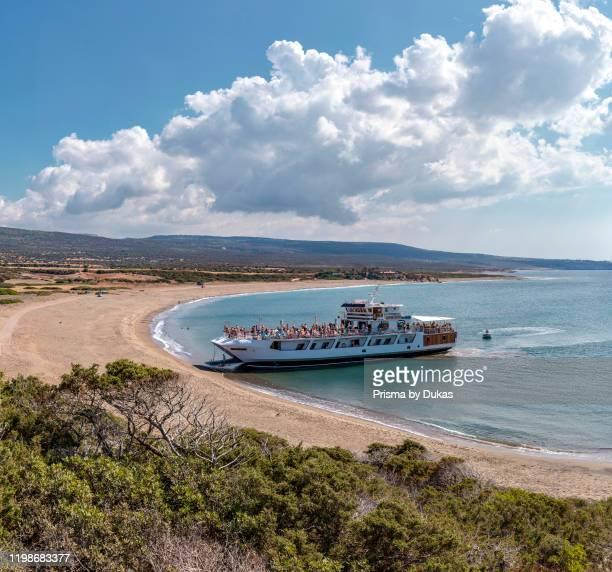 Excursion ship moors at Lara Beach, Akamas Peninsula National Park, Cyprus, Cyprus, 30070089.
