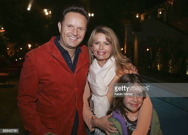 Exec Prod Mark Burnett with actress Roma Downey and daughter Reilly Marie pose at CBS's Rock Star INXS Jam Sessions at the Rock Star Mansion on...
