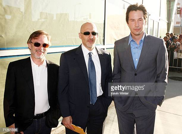 Exececutive Producer Erwin Stoff Warner Bros' Jeff Robinov and actor Keanu Reeves pose at the premiere of Warner Bros Pictures' The Lake House at the...