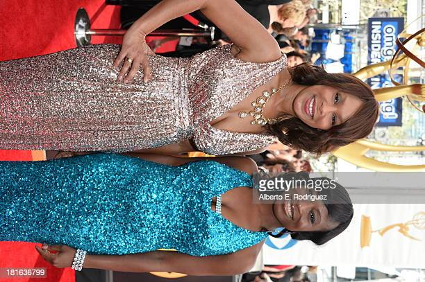 ABC execs Channing Dungey and Nne Ebong arrive at the 65th Annual Primetime Emmy Awards held at Nokia Theatre LA Live on September 22 2013 in Los...