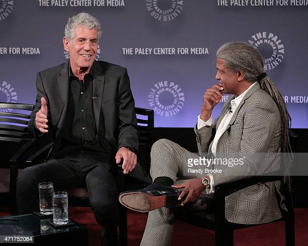 Exectutive producer and chef Anthony Bourdain and panel moderator film critic radio television host and Harvard guest lecturer Elvis Mitchell during...