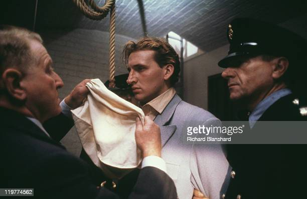 Executioner Albert Pierrepoint played by Clive Revill puts a bag over the head of Derek Bentley played by Christopher Eccleston before his execution...