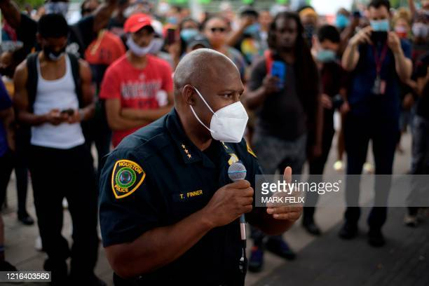 Executive assistant chief of Houston Police Department Troy Finner addresses a crowd gathered during a Justice for George Floyd event in Houston...