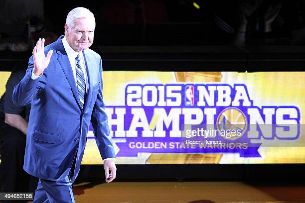 Executive Board Member Jerry West waves to the crowd during the ring ceremony for the 2015 Golden State Warriors championship season prior to the NBA...