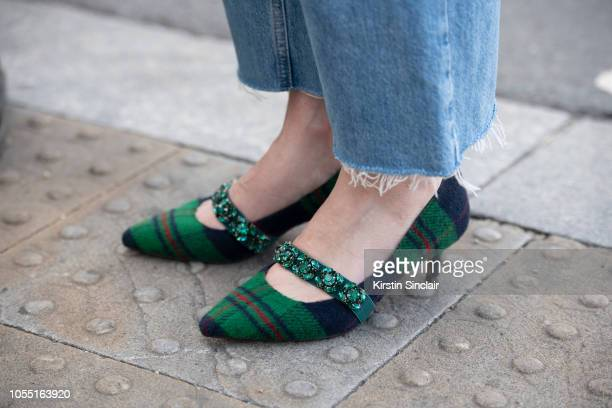 Executive brand editor at Porter magazine Sarah Bailey wears Essentiel Antwerp shoes and vintage jeans during London Fashion Week September 2018 on...