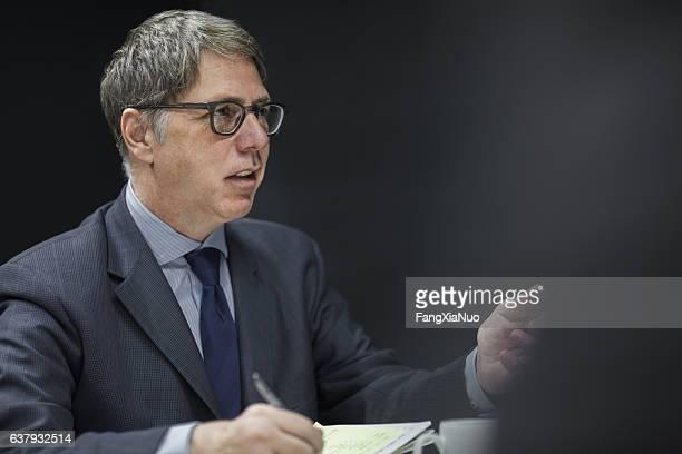 Executive businessman talking in meeting