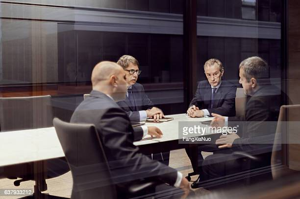 executive businessmen talking in meeting room - private stock pictures, royalty-free photos & images