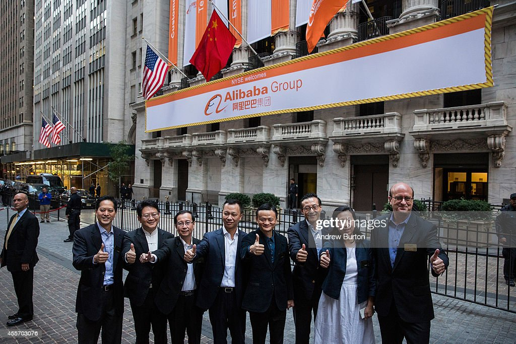 Executive Chairman of Alibaba Group Jack Ma (C) and other executives pose for a photo outside the New York Stock Exchange prior to the compadsny's initial price offering (IPO) on September 19, 2014 in New York City. The New York Times reported yesterday that Alibaba had raised $21.8 Billion in their initial public offering so far.