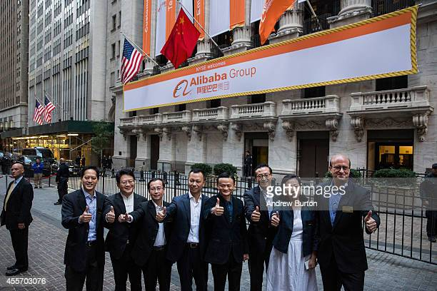 Executive Chairman of Alibaba Group Jack Ma and other executives pose for a photo outside the New York Stock Exchange prior to the compadsny's...