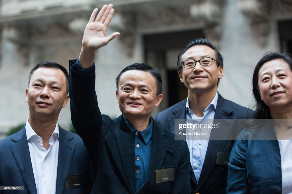 Executive Chairman of Alibaba Group Jack Ma (2nd from L) poses for a photo outside the New York Stock Exchange prior to the company's initial price offering (IPO) on September 19, 2014 in New York City. The New York Times reported yesterday that Alibaba had raised $21.8 Billion in their initial public offering so far.
