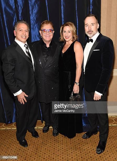 Executive Chairman of Mylan Robert J Coury Sir Elton John CEO of Mylan Heather Bresch and filmmaker David Furnish attend Elton John AIDS Foundation's...