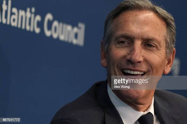 Executive Chairman of Starbucks Corporation Howard Schultz participates in a discussion at the Atlantic Council May 10 2018 in Washington DC The...