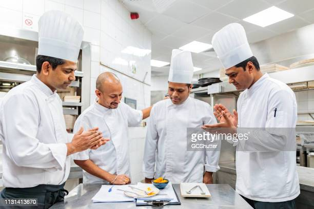 executive chef appreciating the new recipe prepared by a sous chef - admiration stock pictures, royalty-free photos & images