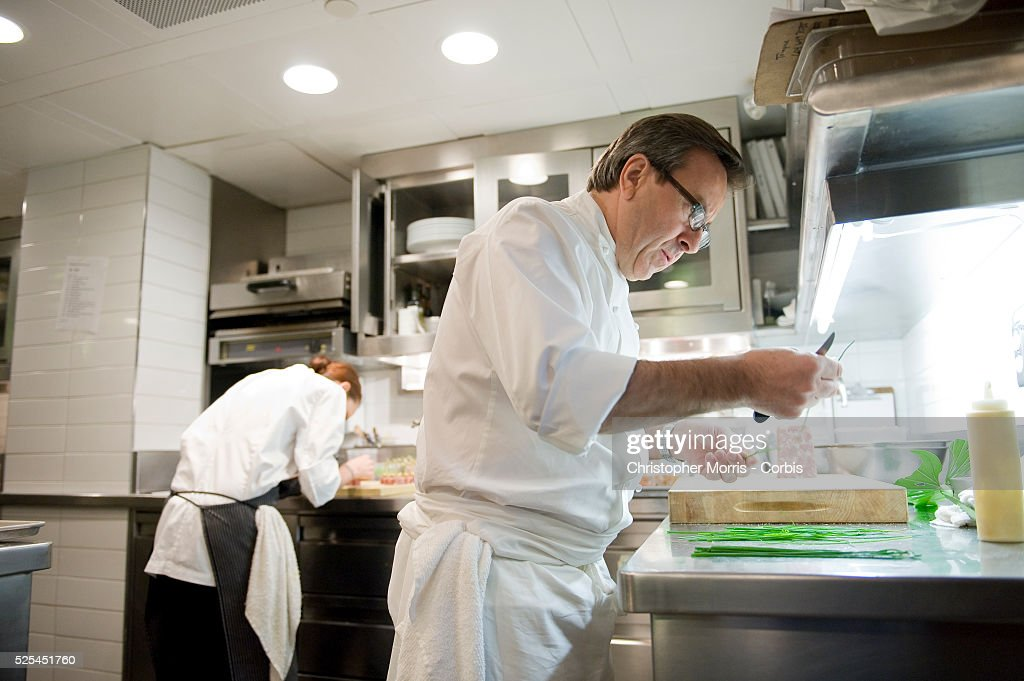 Executive Chef Daniel Boulud Working In The Kitchen At Lumiere Restaurant  In Vancouver. Boulud Has
