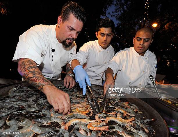 Executive chef Mike Minor and cooks Daniel Pineda and Javier Rosete cook Blue Oasis Pure Shrimp from the company's North Dakota research and...