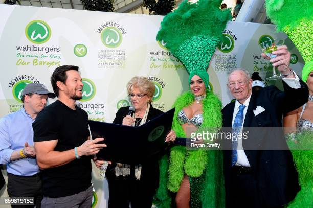 Executive chef Paul Wahlberg and actor Mark Wahlberg accept a proclamation and a ceremonial key to the Las Vegas Strip from Las Vegas Mayor Carolyn...