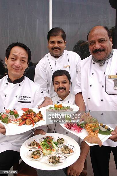Executive Chef Ravitej Nath with Chef Manav Sharma Chef AS Qureshi and Chef Lam Kwai Tong in New Delhi India