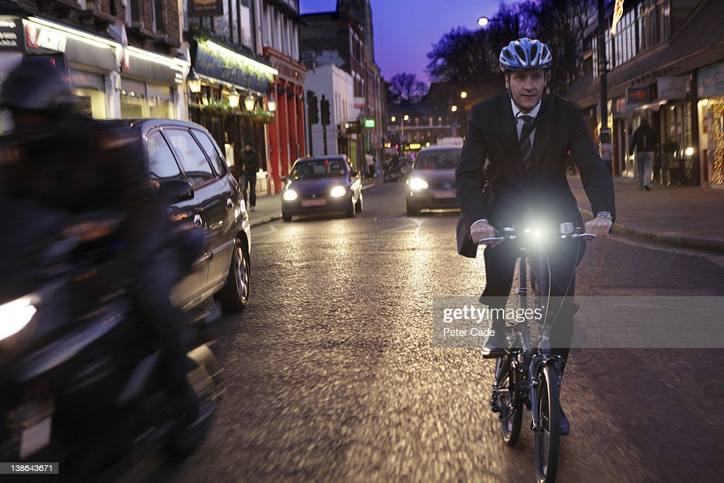 executive commuting by bike in the city : Stock Photo