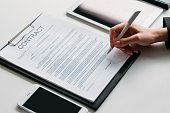 executive decision female leader signing contract
