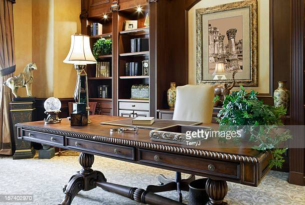 executive desk in a beautiful home office - president stockfoto's en -beelden