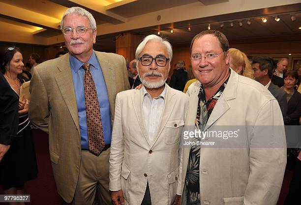 AMPAS executive director Bruce Davis poses with John Lasseter chief creative officer of Pixar and Disney Animation Studios and principal creative...