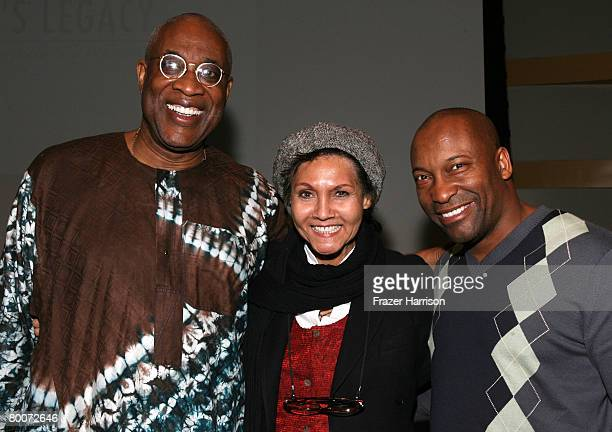 Executive director for the Pan Africian Film Festival Ayuko Babu actress Marki Bey and director John Singleton pose at the AFI Screening of The...