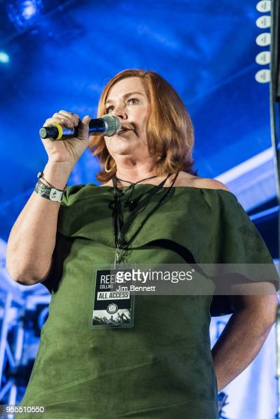 Executive director of HAAM Reenie Collins speaks to the audience live on stage at Ray's 67th birthday party concert benefiting Health Alliance for...