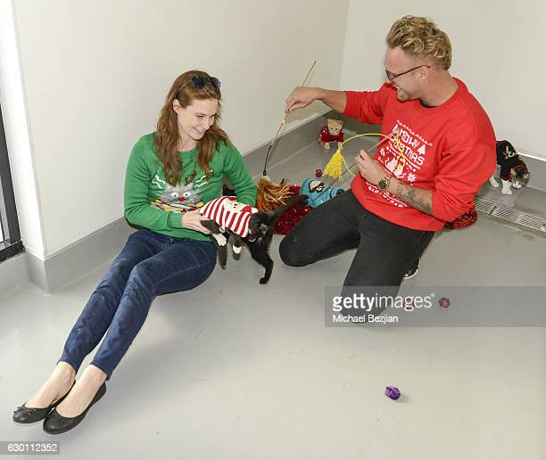 Executive Director of Michelson Found Animals Aimee Gilbreath plays with adoptable cats at Michelson Found Animals Celebrates National Ugly Christmas...