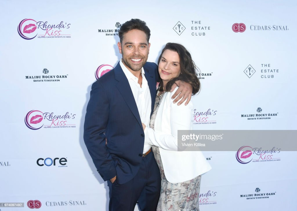 Executive director of Rhonda's Kiss Kyle Stefanski and Julie Barzman attend Rhonda's Kiss 'Kiss The Stars' Cancer Fundraising Dinner at The Estate Club's Sky Castle Estate on June 13, 2018 in Los Angeles, California.