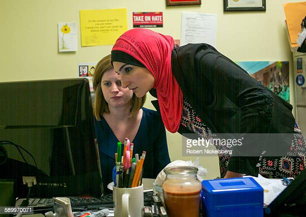 Executive Director of the ArabAmerican Association of New York Linda Sarsour and her assistant director Kayla Santosuossa looks a computer monitor...
