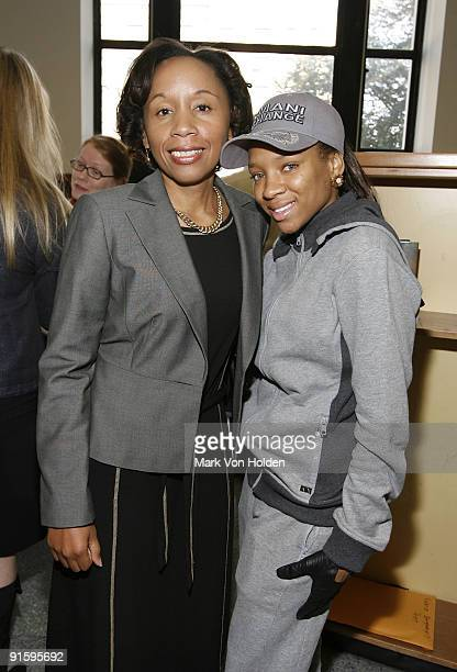 Executive director of the Brooklyn Public Library Dionne MackHarvin and Lil' Mama poses at Jump Start's 'Read for the Record' event at Brooklyn...