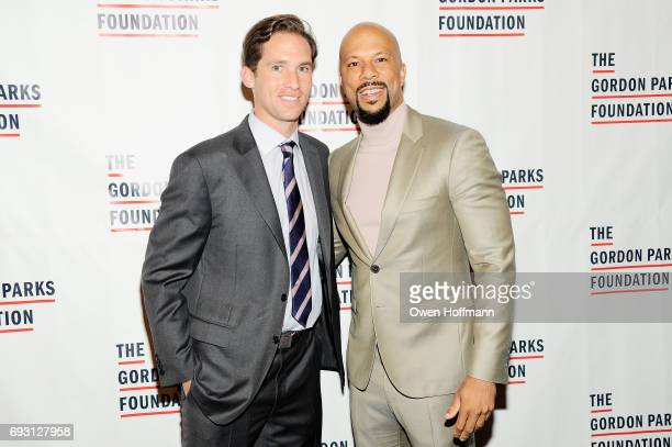 Executive Director of the Gordon Parks Foundation Peter Kunhardt Jr and Rapper Common attend the Gordon Parks Foundation Awards Dinner Auction at...